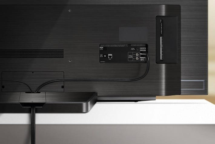 The OLED65C9 features a new cable tidy system.